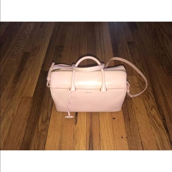 Saint Laurent (YSL) classic duffel bag. M 5b943eab9539f7b600b8a811 6ea8a04e2679a